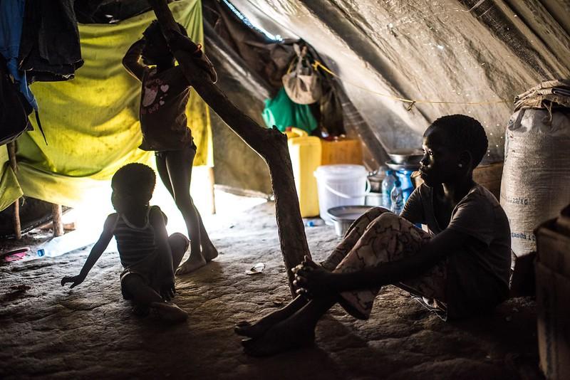 Living in basic tents - Lona Kiden's children in their tent in Bidi Bidi refugee camp in Uganda. Photo : Tommy Trenchard / Caritas