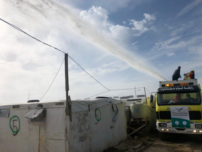 Trócaire's local partner SAWA, sanitising Syrian refugee camps in Lebanon to tackle the challenge of Covid. Photo : SAWA
