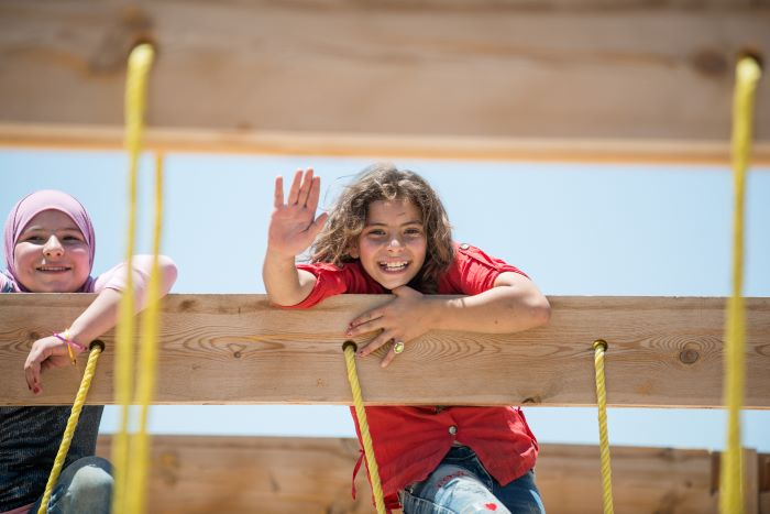 In SAWA's Safe Haven Centre, the refugee children enjoy playing on the swings, clambering up the climbing frame and spinning around in the playground. Photo: Simon Walsh / Trócaire.