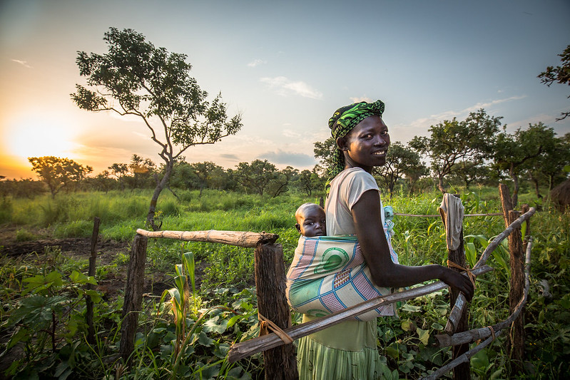 Yaka Lucia with her baby Rosa in Palabek refugee camp in Uganda. Yaka is a refugee who fled from South Sudan's civil war. Trócaire is supporting people like Lucia to grow crops to provide food and income. Photo : Sarah Fretwell