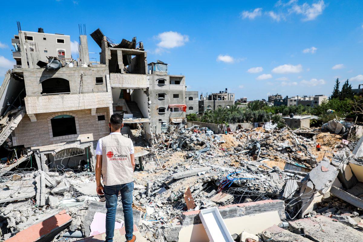 A member of staff from Caritas Jerusalem, a Trocaire partner, surveys the devastation in Gaza. Photo: Michelle Hough, Caritas