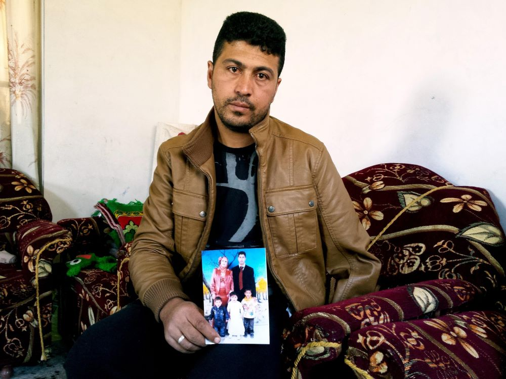 Nabil Siyam shows a photo of his wife and children who were killed in an Israeli airstrike in 2014. Photo : Garry Walsh.