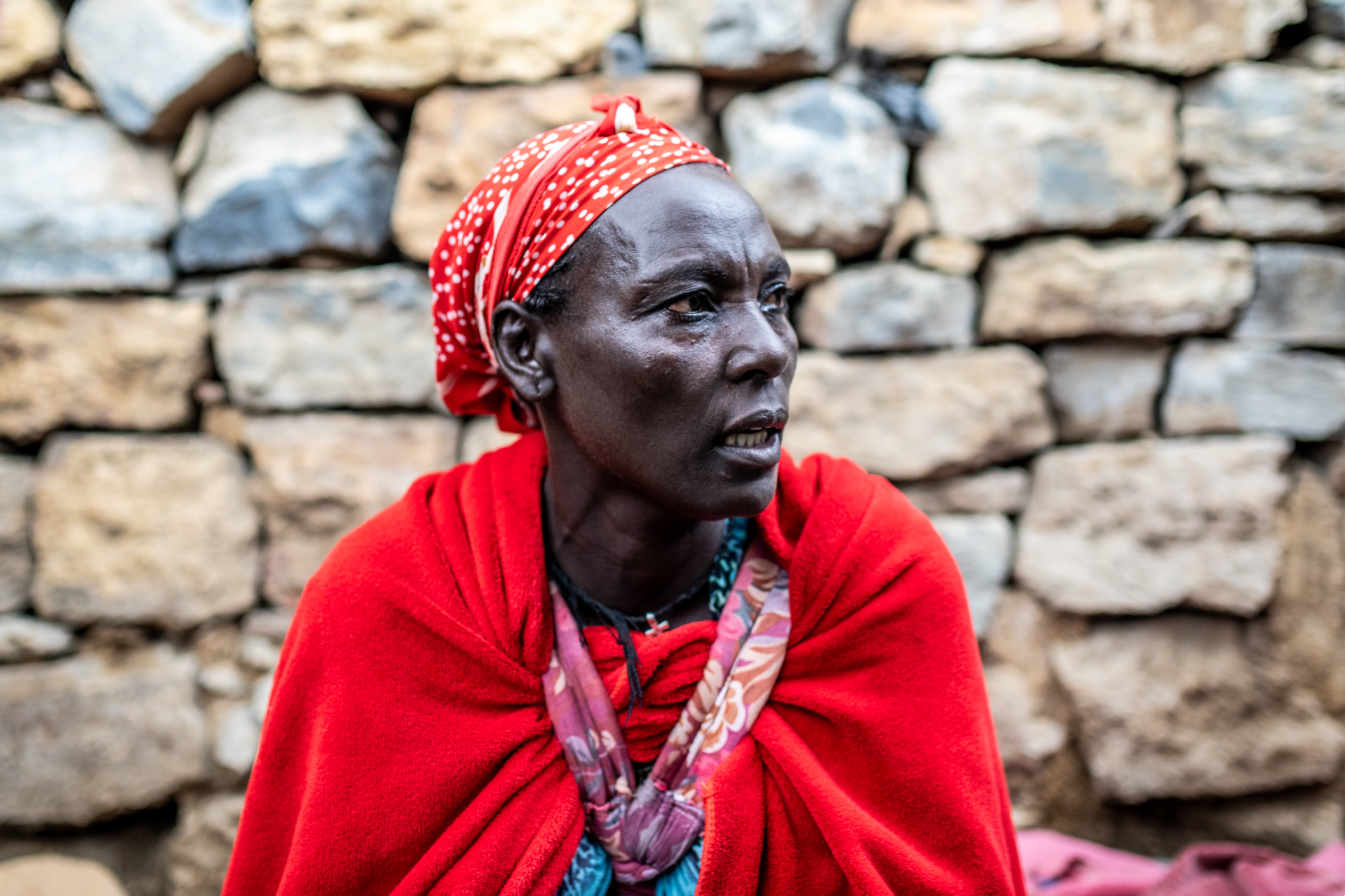 Gidey Gessesse, 42, sits in her home in Hadnet subcity, Mekelle. Gidey has been house-bound since Covid and the Tigray conflict started, unable to generate an income or leave her home for fear of attack.