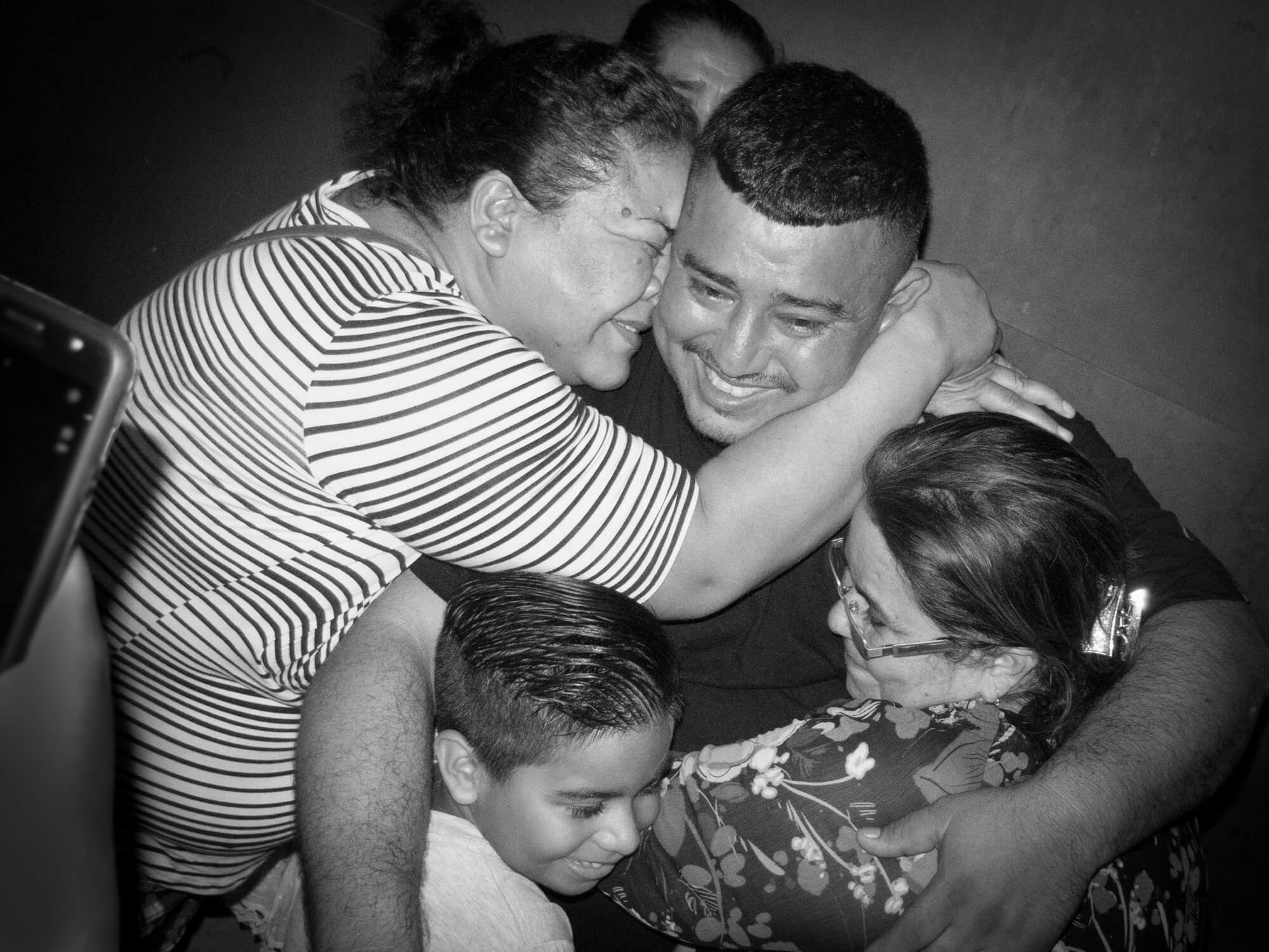 Neighbours hugging Jhony after four months in pretrial detention at the El Progreso prison Photo Credit: Radio Progreso