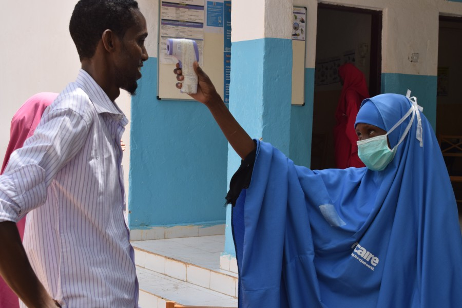 Habiba Mohamed, one of Trócaire's health workers, checks the temperature of Mohamed Abdi Ali at Luuq hospital, in the Gedo region of Somalia.