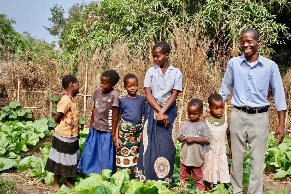 Overton and Patricia with their children Chisomo, Victoria, Rebecca Unboni, Zisiya in Malawi. Photo: Karen McHugh.